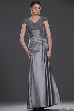 Cap sleeve mother of the bride evening gowns work for many formal occasions. This platinum grey colored evening dress has a empire waist where the upper bodice is beaded.  Satin is a popular choice for #motherofthebridedresses at #weddings . Our design firm can recreate this style of formal dress for you with any changes.  (We specialize in custom #eveningdresses & replicas of couture gowns.)  See more options and get pricing on any picture at www.dariuscordell.com