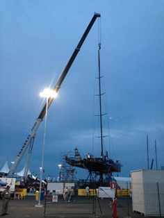are putting her rig back in. The boat will be in the water Saturday morning in time for the in-port race (by Patrick Shaughnessy) Volvo Ocean Race, Saturday Morning, Rigs, Wind Turbine, Sailing, Porn, Water, Candle, Gripe Water