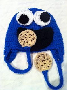 Cookie monster earflap hat with decorative cookies  @Sasha Hatherly Johns  you know you want to crochet now