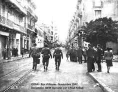 Operation Torch, November Americans walking down a street in Oran, North Africa, U. Army Signal Corps Photograph released December Courtesy of the Library of Congress. Photographed through Mylar sleeve. Us Marines, Casablanca, Le Bled, Operation Torch, Walking Street, American Red Cross, Military Personnel, American Soldiers, Library Of Congress