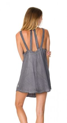 The Tunnel Vision Dress by RVCA has a strappy back detail