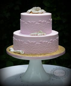 Pink bridal shower cake with wave effect and hand made shells