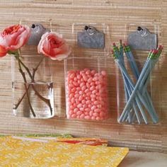 Zinc Wall Accessories   ///     Keep flowers, mail or favorite objects in clear view. Each wall pocket is hand-finished of clear glass and mounts with iron push pins. Write with chalk on the zinc hang tags to label the contents. A stylish way to display everyday objects.
