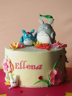 I like the lettering. Not sure who the creatures are, but like idea of instead  using with birds, owl's, etc.     = Totoro's garden cake (by baa baa bake)