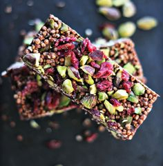Quinoa Coconut-Cacao Bar Melt together: 6 Tbsp coconut oil 2 Tbsp coconut butter 4 heaping Tbsp of raw cacao powder (or regular unsweetened cocoa powder will do, if you don't have cacao) 2 Tbsp of maple syrup pinch of salt Stir in 1 cup Puffed Quinoa Cereal 1/4 cup Cranberries 1/4 cup pistachios Pour into a lined loaf pan and chill until set.