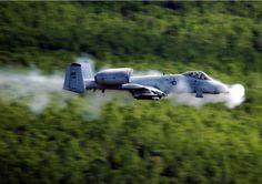 "A-10 Thunderbolt II (""Warthog"") close air support (CAS) jet aircraft firing its 30 mm GAU-8/A Avenger Gatling-type cannon."