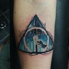 Harry Pottery tattoo by Zachary Bohanan. #HarryPotter #DeathlyHallows #tattooart