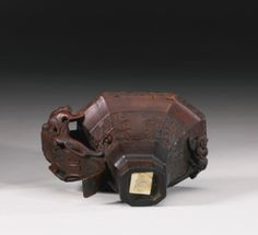 AN ARCHAISTIC RHINOCEROS HORN 'CHILONG' LIBATION CUP 17TH / 18TH CENTURY - Sotheby's