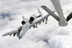 An A-10C Thunderbolt II departs after completing air-to-air refueling from a KC-135 Stratotanker while over Michigan, Sept. 13, 2013. The A-10 is assigned to the 107th Fighter Squadron and the KC-135 to the 171st Air Refueling Squadron at Selfridge Air National Guard Base, Mich. (U.S. Air National Guard photo by Master Sgt. David Kujawa/Released)