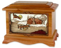 Lovely cabin scene cremation urn. Our hardwood cremation urns are made here in Oregon, USA by master craftsmen. Made in Oak, Walnut, or Maple.
