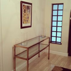 Brass and glass entrance table.