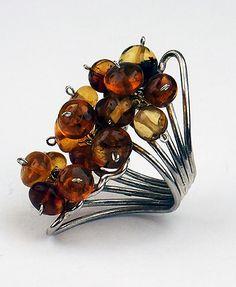 A floral adjustable ring made with Mexican amber. Anillo Racimo de Ámbar con Plata Gde. » Joyería   Arte   Diseño