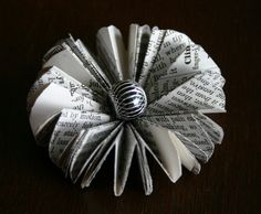 I& been making flowers out of book pages lately. Here are some pics of some of them. They are all made from book pages except the b. Old Book Crafts, Book Page Crafts, Book Page Flowers, Book Page Wreath, Recycled Books, Magazine Crafts, Book Folding Patterns, Folded Book Art, Tissue Paper Flowers
