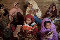 Internally displaced young girls from the Swat valley recite the Koran at a Madrassa in the Shah Mansoor IDP camp on July 1, 2009 in Swabi District, Pakistan.  July 1, 2009 - Source: Getty Images AsiaPac