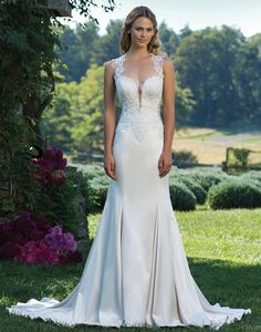 Sincerity wedding dress style 3921 Fit and flare stretch Satin gown featuring a Queen Anne neckline, nude side panels and back, beaded embroidered lace, and a chapel length train.