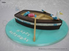 Rowing Boat Cake. Life is but a dream... Novelty shaped rowing boat cake with suitcases and seagull. A send up for a upcoming cruise trip