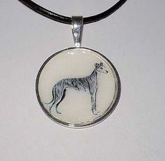 "Altered Art Dog Jewelry. Vintage pencil sketch of a standing brindle Greyhound or Whippet in a silver plated setting - the lovely pendant is approximately 1"" di"