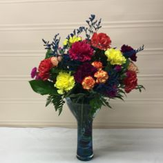 This bouquet of flowers is designed from the seasons best flowers. Each made in an array of colors that is pleasing to the eye and displayed in this unique blue vase. Send Flowers, Fresh Flowers, Local Florist, Amazing Flowers, Flower Designs, Flower Arrangements, Glass Vase, Bouquet, Plants