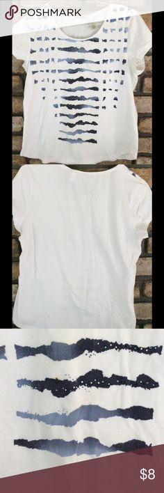 Zenergy White & Blue Top - NEW LISTING Chico's Zenergy Top. It's a white short sleeve top. Has shades of blue design on the front. Top does have a coulee marks on it, they are not extremely noticeable due to the design, but price does reflect this. If you purchase the navy cotton capris, the top is free!! Chico's size is a size 2 is a size 12 - 14 Chico's Tops Tees - Short Sleeve