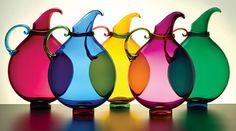 Hand blown glass pitchers by Michael Schunke.