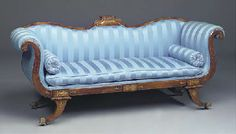A REGENCY ROSEWOOD AND BRASS INLAID SOFA