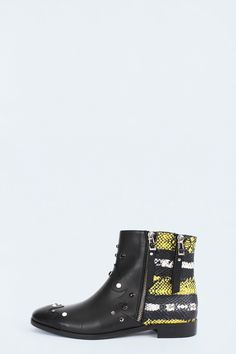 Zadig et Voltaire boots, two different materials, double zip on the outside, engraved pullers ans leather straps, strass rivets, leather sole and 2 cm hell, cow leather and snake printed calfskin. Fit normally, take your usual size.