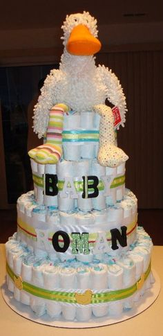 4 tier diaper cake:over 200 size 1 diapers, stuffed animal, decorations