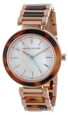 The #Kenneth Jay Lane 2000 Series watch strikes a modern, sophisticated note. The perfectly round case is presented on an attractive triple link bracelet with de...