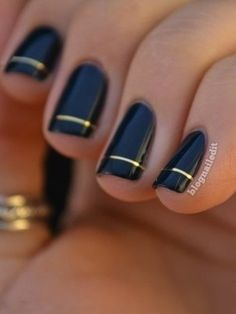 Black glaze nails with gold detail. Simple elegance.