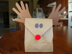 Paper bag Rudolf - Christmas craft (great idea for kids to bring home their party treats and gifts)