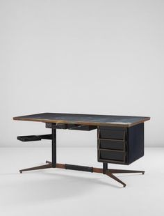 GIO PONTI  Rare desk  circa 1956  Painted steel, brass, laminate-covered wood, rubber.  30 x 66 3/4 x 31 1/2 in. (76.2 x 169.5 x 80 cm)  Manufactured by Rima, Padua, Italy. Together with a certificate of authenticity from the Gio Ponti Archives.