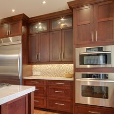 cherry cabinets with white speckled countertop and do you like the backsplash here?