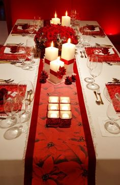 On this long table there's only one floral piece the rest of the space is taken up with thoughtfully placed candles