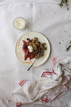 Beautifully roasted rhubarb in orange juice and served with chunky fig granola clusters. Hello summer!! :)