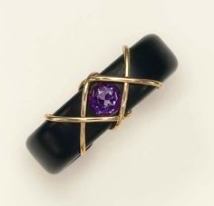 A WOOD AND AMETHYST BRACELET, BY JAR  Designed as a wooden cuff, centering upon a circular-cut amethyst, enhanced by polished gold wirework detail, mounted in gold and silver gilt, Joel A. Rosenthal, JAR, dated 22 November 2004