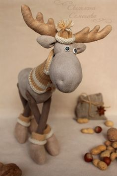 Fabric moose in hat and sweater.