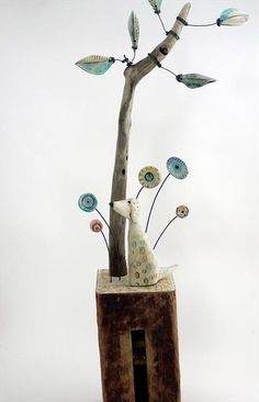Cheerful, colourful assemblage inspired by sunny summer days. Earthenware. driftwood,vintage map. 21cm x 15cm x 4cm. £110.00. Can be seen at Shirley Vauvelle Studio.