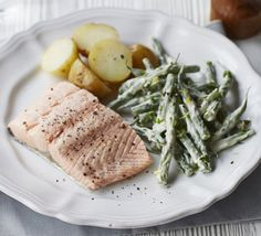 Lightly poach salmon fillets and serve with creamy green beans and baby new potatoes for a light meal