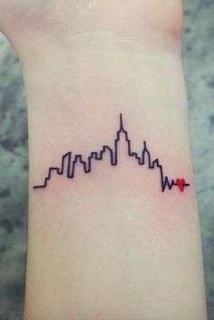 Tiny, delicate wrist tattoos look beautiful - click to see some of our favorites (and get ideas if you're thinking about some ink for yourself!) How amazing is this city skyline tattoo?