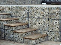 Gabion baskets are filled with rocks as steps and wall. Gabion baskets are filled with rocks as steps and wall. Gabion Stone, Gabion Retaining Wall, Gabion Fence Ideas, Retaining Wall With Steps, Garden Stairs, Backyard Fences, Garden Walls, Fence Design, Garden Design