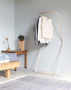 Love this hanging rail; simple and elegant. Perfect for open space living as a feature. Eye-Catching Dutch Design You've Gotta See - Apartment34