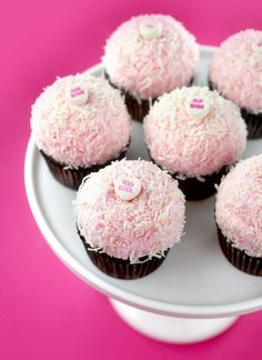These chocolate cupcakes covered in pink fluff frosting and shredded coconut are dreamy and delicious. I made these bundles of joy from Passion for Baking's new cookbook. Do you know Manuela? She's a blogger/baker from Norway and she makes the most beautiful desserts. All of her sweets and photos are impeccable. I first found her on instagram and was immediately wowed. Check her out on instagramand her blog ifyou want to know more. You won't be disappointed. In the meantime, let's love on…