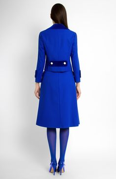 Double-breasted stretchy cotton suit. Velvet finish on the collar, cuffs and patch pockets. A-shape skirt with hidden back zip closure.