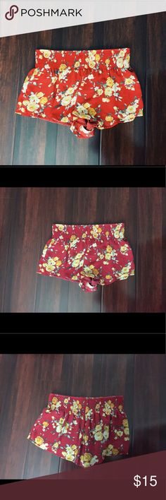 Red Flower Print Chiffon Shorts These light, airy and fun flower print shorts are a summer must have! The material is incredibly comfortable for a warm summer day. They feature a thick elastic waistband for a comfortable fit, and generous range in size. These shorts are in perfect condition, and are a size Large, but fit a Medium as well. Pictures 2-4 are actual color representation in day light. Forever 21 Shorts