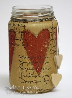 Jam jar with tissue paper and stamps