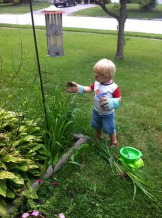It's a Riley Friday Blast from the Past -- he's helping his Mommy out in the garden!
