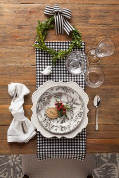 Black and white with touches of greenery is a timeless look that's always in style. Use your everyday white dinnerware and add a few special pieces for a classic holiday table.