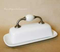 BIG Tip of the Day!  Glue a handle/drawer pull to a butter dish for easy access and a whole new look!  {Rescape.com}