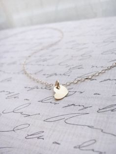 Tiny Heart Disk necklace by Olive Yew is adorable in gold, silver or rose gold. You can also customize  by adding an initial.