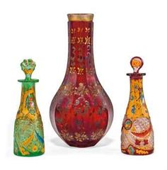 Two Bohemian Cut & Enamelled Glass Scent Bottles & Stoppers & a     Bottle Vase: Late 19th century. The scent bottles are cut with foliate-shaped panels of hobnail & enamelled with flowers & scrolls, the bottle vase of panelled form.